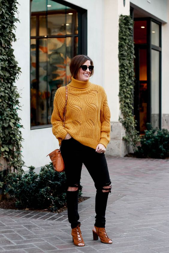 Black jeans with round neck sweater